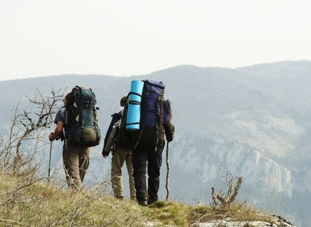 Backpackers going up along hill Stock Photo - 867023