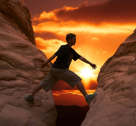 girl climbing on the rock on sunset background Stock Photo - 867028