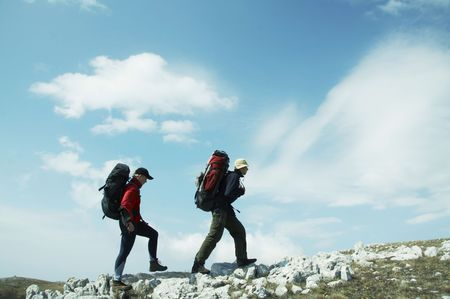 Two person going up along hill Stock Photo - 867986