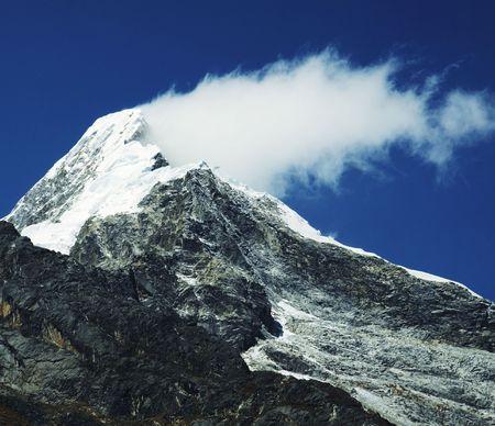 Mountain peak and cloud
