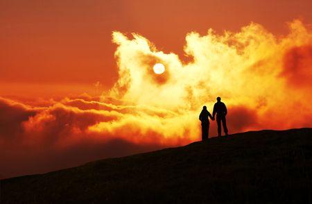 Couple on sunset background photo