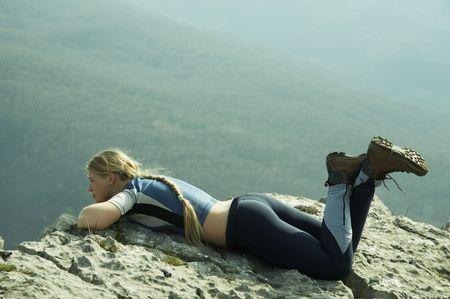 overview: Girl overview landscapes on rock Stock Photo