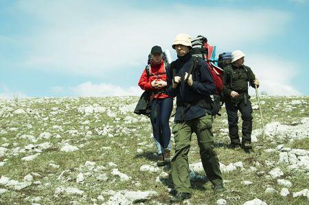 Backpackers in hike photo