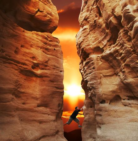 Girl climbing in canyon walls on sunset