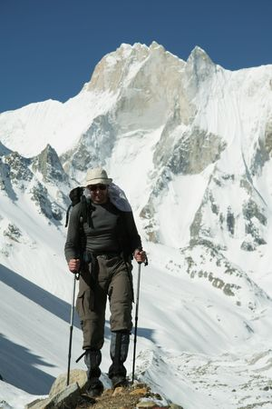 Climber going in Himalayans mountain photo