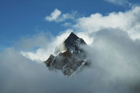 Mount peak in clouds in Himalayan Stock Photo