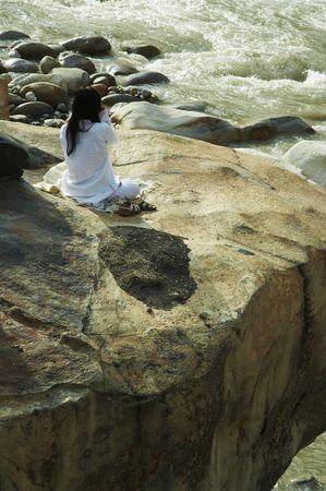 sacred source: Yoga on Ganga bay Stock Photo