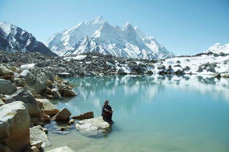Girl relaxing on mountains lake photo