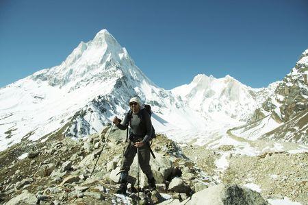shivling: Hiker going along morane in Himalayan mountain Stock Photo
