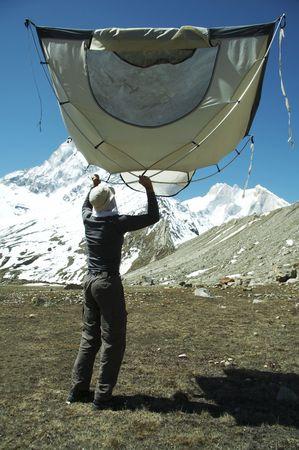 shivling: Climber and tent in Himalayan mountain