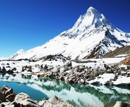 shivling: Shivling peak and beautiful lake in Himalayan