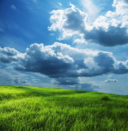 Green grassland and storm cloud Stock Photo - 1281513