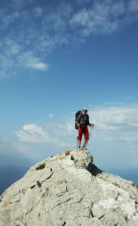 Male standing on the stones cliff Stock Photo - 1281622