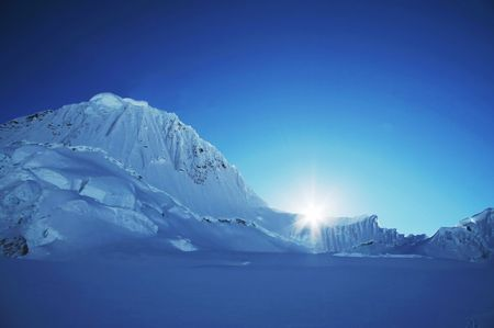 Sun and snow mountains landscape
