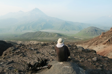 Man on the cliff in Kamchatka mountain Stock Photo - 1431090