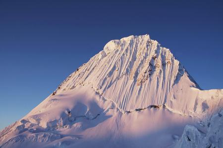 alpamayo: Alpamayo peak on sunset in Cordilleras