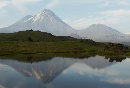 Lake and volcano on Kamchatka photo