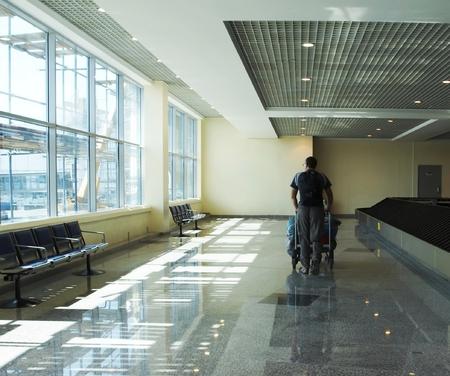 thru: Man traveler walking thru airport terminal