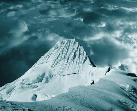alpamayo: Beautiful peak Alpamayo in storm