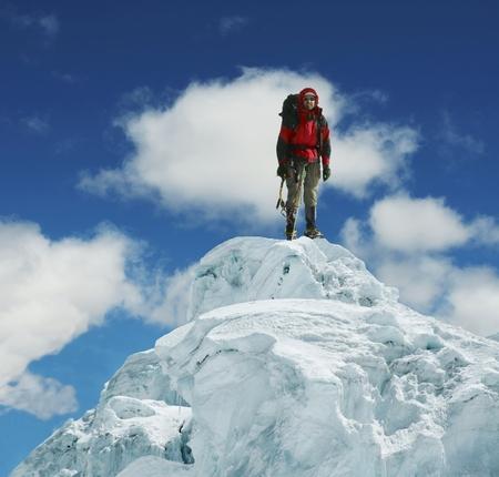 Climber on snowy summit photo