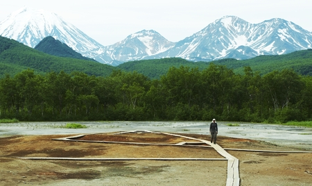 overtone: Man walking of the hydrotermal park  on Kamchatka Stock Photo