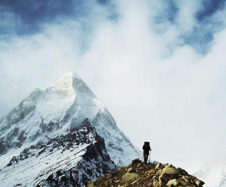 shivling: Hiker going along snowy slope in Himalayan mountain
