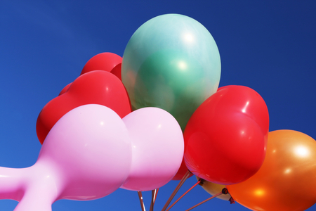depart: Balloons depart to the sky Stock Photo