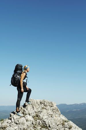 Girl overview landscapes in mountain photo