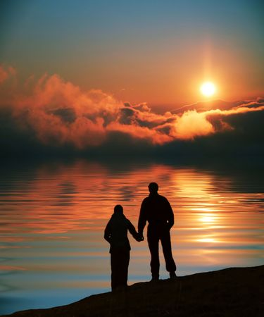 outdoor walking: Couple on sunset Stock Photo