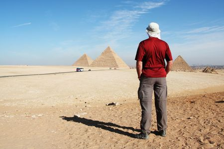 Man looking on pyramids Stock Photo - 2268929