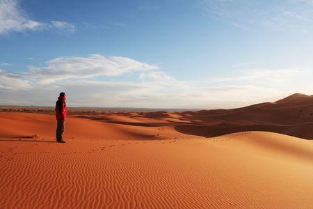 to observer: Man observer  sand desert