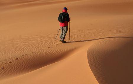 Man observer  sand desert photo
