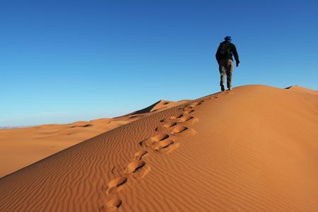 go up: Man go up in sand desert