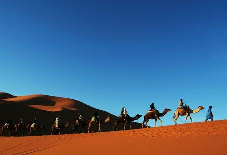 Hiker in Sahara desert photo