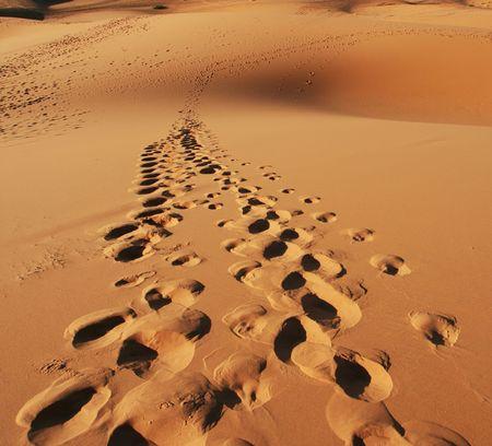 Footprints on the sand photo
