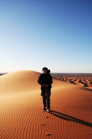 Man go up in sand desert photo