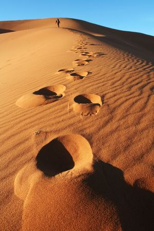 Man go up in sand desert Stock Photo - 2584282