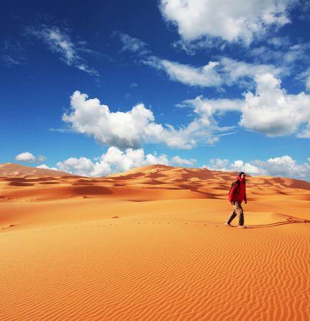 Men in sand desert photo