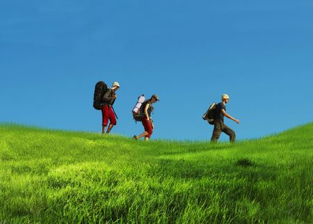 Hikers on grassland photo
