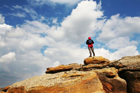 Male stand on the rock Stock Photo - 2808317