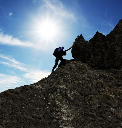 top of mountain: girl climbing on the rock