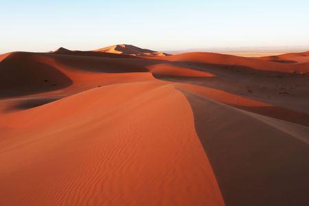 Hiker in sand desert photo
