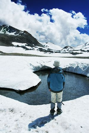to observer: Boy on mountain lake