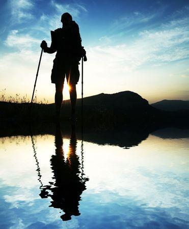 exultation: Man silhouette on sunset