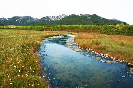 Creek in mountain photo