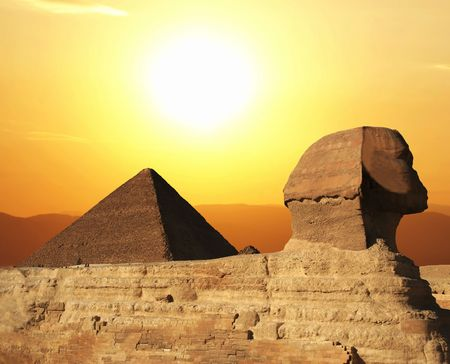 Egyptian sphinx and pyramid on sunset Stock Photo - 3302554