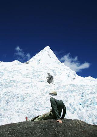 alpamayo: Man relaxing in mountains Stock Photo