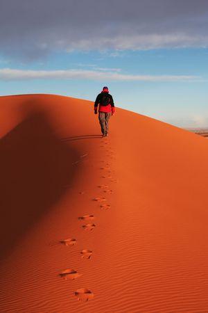 Hike in sand desert photo