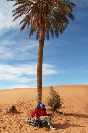 Man in  sand desert photo