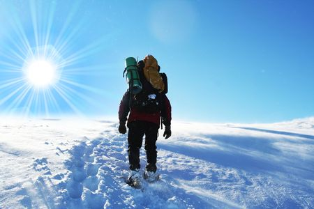hikers in winter mountain photo